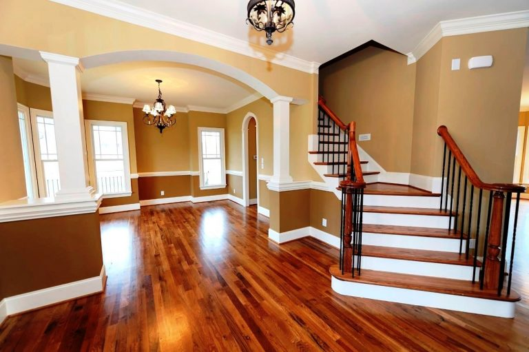 hardwood floor entryway and dining room