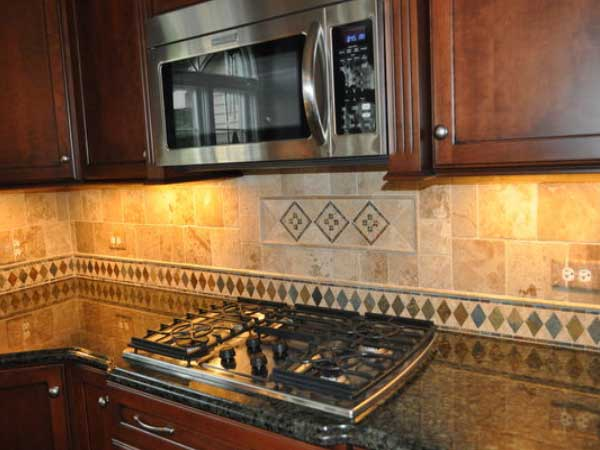 Marble Tile Backsplash with Decorative Mosaic