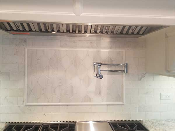 Marble Backsplash With Mosaic Accent